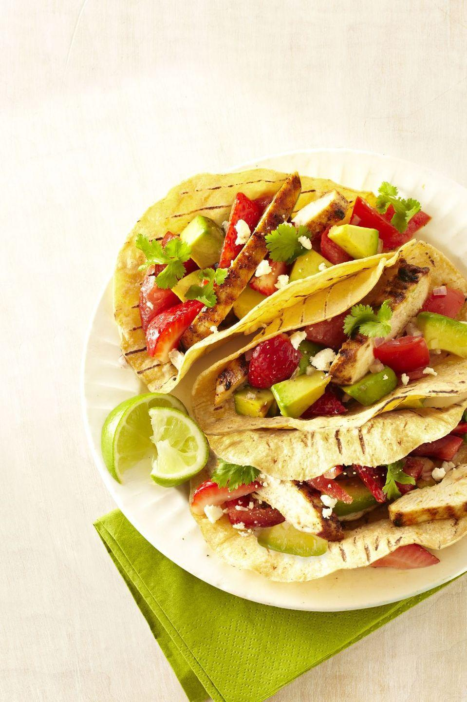 """<p>This chicken taco recipe calls for sweet strawberries and creamy avocado as a topping ... Need we say more?!</p><p><em><a href=""""https://www.goodhousekeeping.com/food-recipes/a14533/grilled-chicken-tacos-strawberry-salsa-recipe-ghk0713/"""" rel=""""nofollow noopener"""" target=""""_blank"""" data-ylk=""""slk:Get the recipe for Grilled-Chicken Tacos with Strawberry Salsa »"""" class=""""link rapid-noclick-resp"""">Get the recipe for Grilled-Chicken Tacos with Strawberry Salsa »</a></em></p>"""