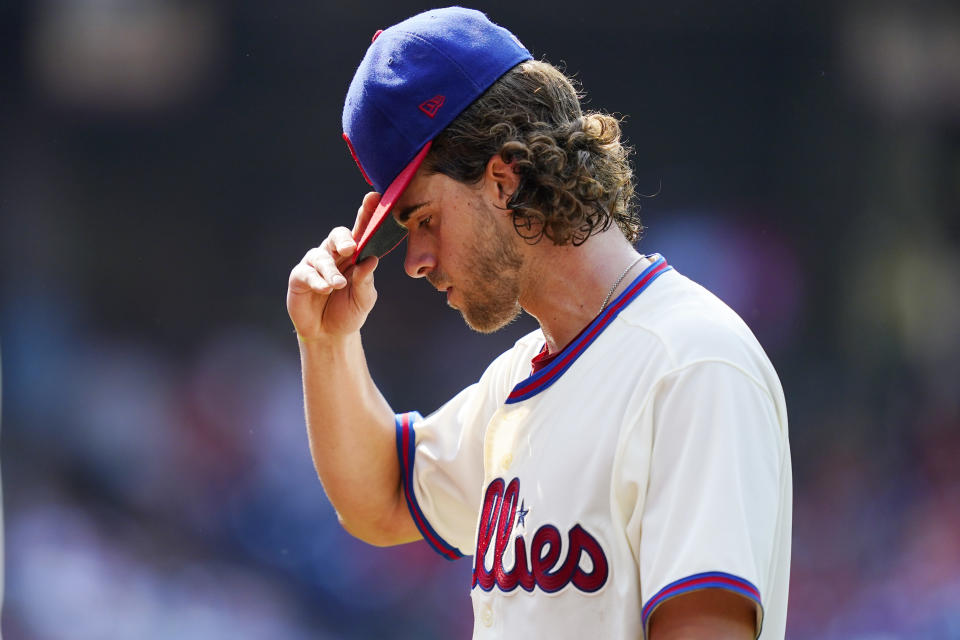 Philadelphia Phillies pitcher Aaron Nola walks off the field after the fifth inning of a baseball game against the Colorado Rockies, Sunday, Sept. 12, 2021, in Philadelphia. (AP Photo/Matt Slocum)