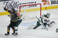 Vegas Golden Knights right wing Mark Stone (61) celebrates after scoring against Minnesota Wild goaltender Cam Talbot (33) during the first period of an NHL hockey game Monday, May 24, 2021, in Las Vegas. (AP Photo/John Locher)