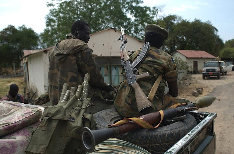 South Sudanese People Liberation Army (SPLA) soldiers sit on a pick up truck during a patrol in Malakal on January 21, 2014