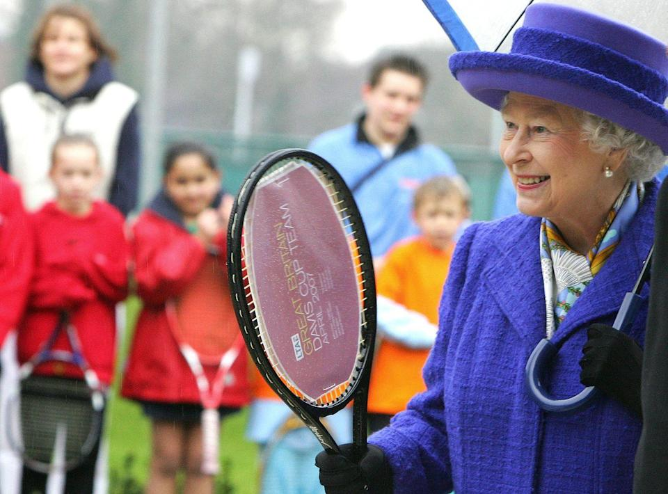 <p>Queen Elizabeth may not have inherited her father's tennis form (Her Majesty is famously more of a riding and racing fan) but she was clearly please to receive a racket from the British Davis Cup.<br></p>