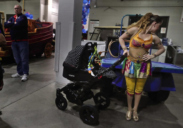 <p>Ringling Bros. high wire performer Anna Lebedeva stands next to her 3-month-old son, Amir, in his stroller while waiting to go on for the show's finale, Friday, May 5, 2017, in Providence, R.I. Lebedeva and her husband, fellow performer Mustafa Danguir, dream of starting their own show, or maybe opening a circus school in Morocco to teach future generations. They're optimistic something good will come along. (Photo: Julie Jacobson/AP) </p>