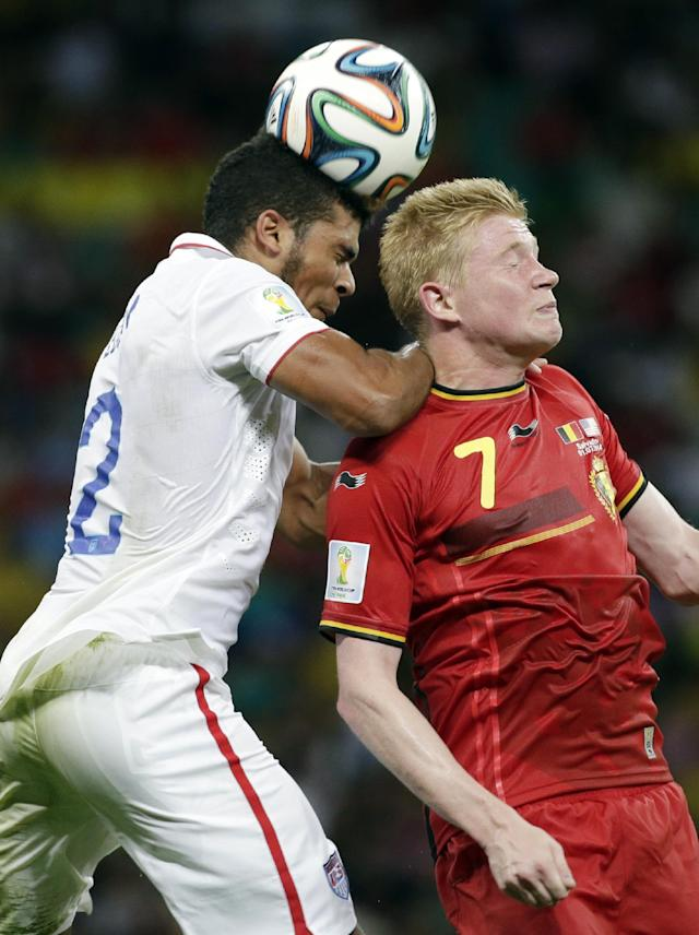 United States' DeAndre Yedlin, left, and Belgium's Kevin De Bruyne (7) go for a header during the World Cup round of 16 soccer match between Belgium and the USA at the Arena Fonte Nova in Salvador, Brazil, Tuesday, July 1, 2014. (AP Photo/Felipe Dana)