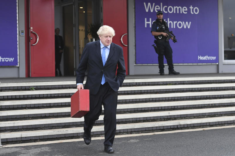 Britain's Prime Minister Boris Johnson walks to board his plane at London's Heathrow Airport as he heads off for the annual United Nations General Assembly in New York, Sunday Sept. 22, 2019. (Stefan Rousseau/PA via AP)