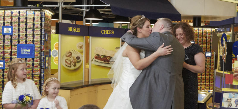 Mark I Love SPAM Benson kisses his bride Anne during the first wedding ceremony to take place at the SPAM Museum in Austin, MN