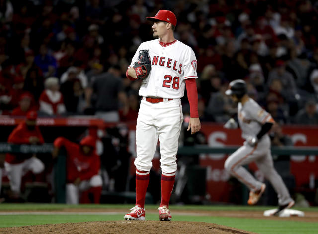 San Francisco Giants' Mac Williamson, right, rounds the bases after a home run off Los Angeles Angels starting pitcher Andrew Heaney during the fifth inning of a baseball game in Anaheim, Calif., Friday, April 20, 2018. (AP Photo/Chris Carlson)