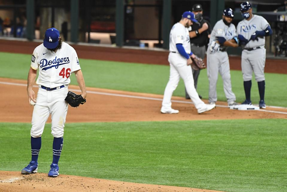 Dodgers pitcher Tony Gonsolin looks down as he gives up a walk to the Tampa Bay Rays' Manuel Margot.