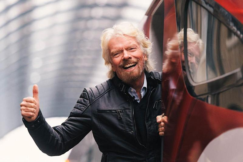 Happier times: Virgin Trains transformed travel on the West Coast main line, but Sir Richard Branson has been stripped of the franchise: Virgin Trains