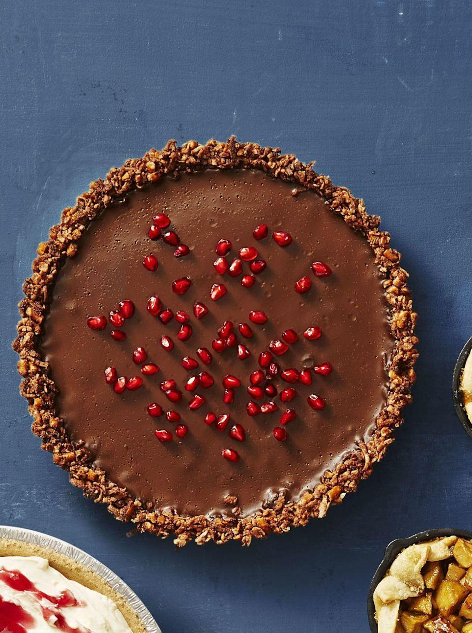 """<p>Talk about a slam-dunk dessert: This pie is vegan, gluten-free and comes together in about a half hour.</p><p><em><a href=""""https://www.goodhousekeeping.com/food-recipes/a41082/gluten-free-chocolate-ganache-tart-recipe/"""" rel=""""nofollow noopener"""" target=""""_blank"""" data-ylk=""""slk:Get the recipe for Gluten-Free Chocolate Ganache Tart »"""" class=""""link rapid-noclick-resp"""">Get the recipe for Gluten-Free Chocolate Ganache Tart »</a></em></p><p><strong>RELATED: </strong><a href=""""https://www.goodhousekeeping.com/food-recipes/dessert/g376/gluten-free-dessert-recipes/"""" rel=""""nofollow noopener"""" target=""""_blank"""" data-ylk=""""slk:25 Gluten-Free Desserts That Will Be the Hit of Any Party"""" class=""""link rapid-noclick-resp"""">25 Gluten-Free Desserts That Will Be the Hit of Any Party</a></p>"""
