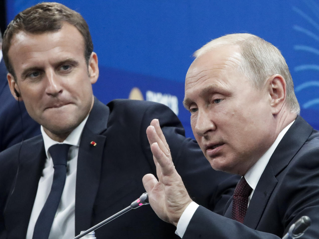 Russian President Vladimir Putin, right, gestures while speaking as French President Emmanuel Macron looks at him at the St. Petersburg International Economic Forum in St. Petersburg, Russia, Friday, May 25, 2018. (AP Photo/Dmitri Lovetsky, Pool)