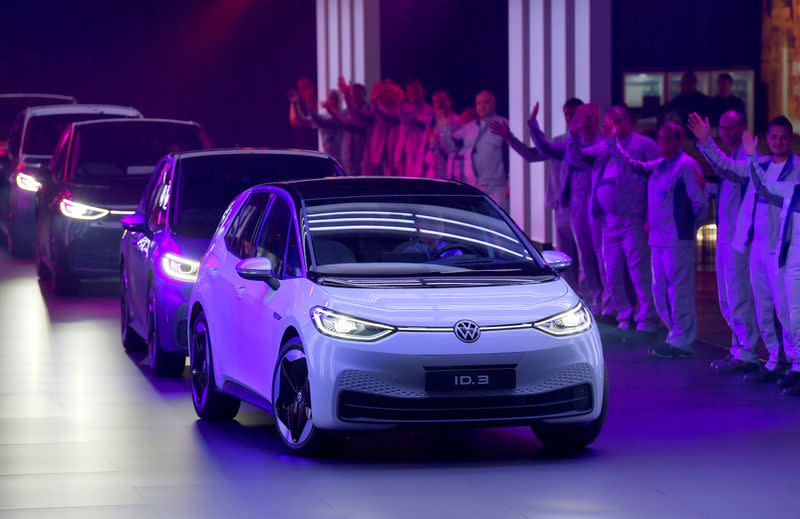 FILE PHOTO: New cars drive during a ceremony marking start of the production of a new electric Volkswagen model ID.3 in Zwickau