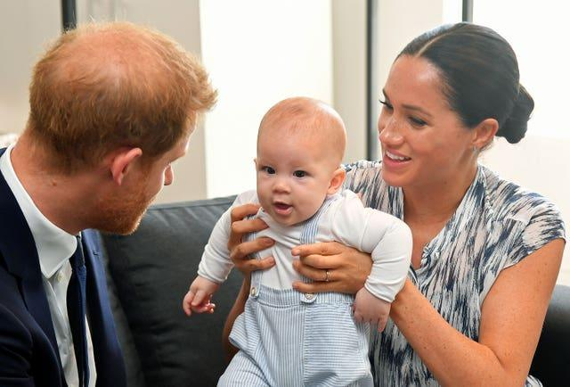 The Duke and Duchess of Sussex holding their son Archie during a meeting