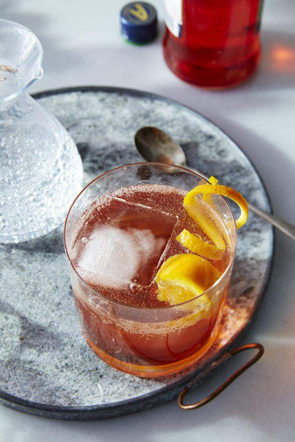 """<p><strong>Recipe: <a href=""""https://www.southernliving.com/recipes/aperol-bourbon-fizz-recipe"""" rel=""""nofollow noopener"""" target=""""_blank"""" data-ylk=""""slk:Aperol Bourbon Fizz"""" class=""""link rapid-noclick-resp"""">Aperol Bourbon Fizz</a></strong></p> <p>A little bit of aperol spritz, a little bit of Old-Fashioned, this recipe brings together two very different cocktails in a tasty new way. For bourbon lovers, it's a no-brainer for when you're feeling like a light sipper. Topo Chico's new Twist of Tangerine flavor would pair well with the citrusy ingredients. </p>"""