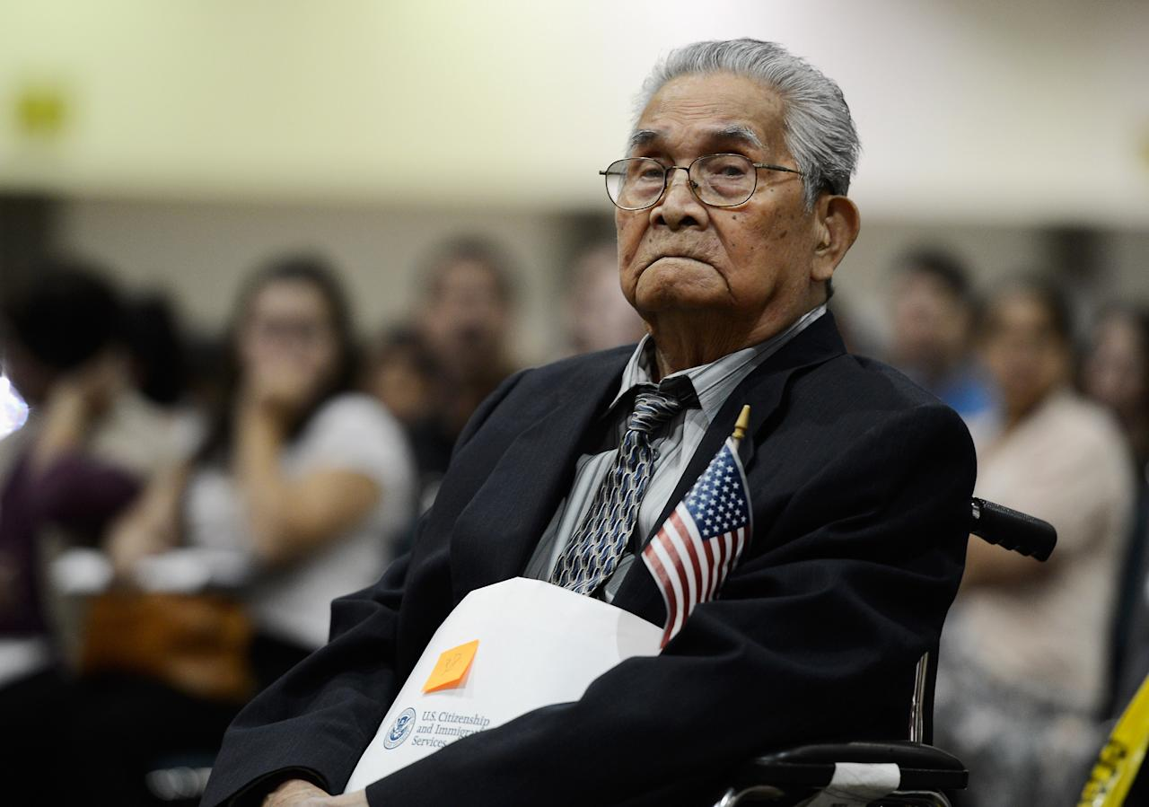 The oldest candidate to become a U.S. citizen 102 year-old Joaquin Arciago Guzman from the Philippines waits to take the oath of citizenship at a naturalization ceremony at the Los Angeles Convention Center on June 27, 2012 in Los Angeles, California. More than 7,000 candidates became citizens representing more than 120 countries.  (Photo by Kevork Djansezian/Getty Images)