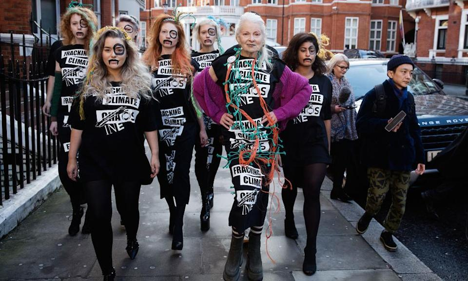 Sign of the times: Vivienne Westwood arrives with models at the #INEOSVTHEPEOPLE catwalk presentation outside Ineos headquarters in London in 2018.