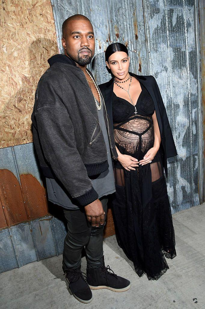 <p>At the Givenchy show during Paris Fashion Week, Kardashian - pregnant with son Saint - and West attend.</p>