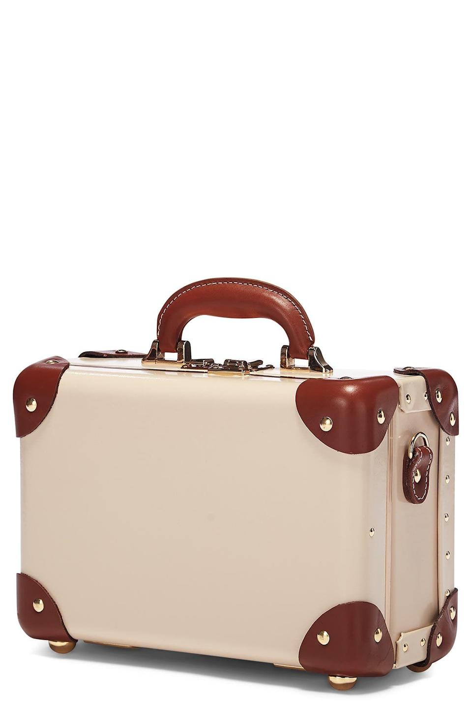"""<p><strong>STEAMLINE LUGGAGE</strong></p><p>nordstrom.com</p><p><strong>$395.00</strong></p><p><a href=""""https://go.redirectingat.com?id=74968X1596630&url=https%3A%2F%2Fwww.nordstrom.com%2Fs%2Fsteamline-luggage-the-diplomat-vanity-case%2F5926198&sref=https%3A%2F%2Fwww.elledecor.com%2Flife-culture%2Ftravel%2Fg36806316%2Fsummer-travel-necessities%2F"""" rel=""""nofollow noopener"""" target=""""_blank"""" data-ylk=""""slk:Shop Now"""" class=""""link rapid-noclick-resp"""">Shop Now</a></p><p>Can a cosmetic bag be any more stylish? Store all your beauty necessities in this mini luggage case—the hard, structured exterior will keep your all your toiletries and makeup safe.</p>"""