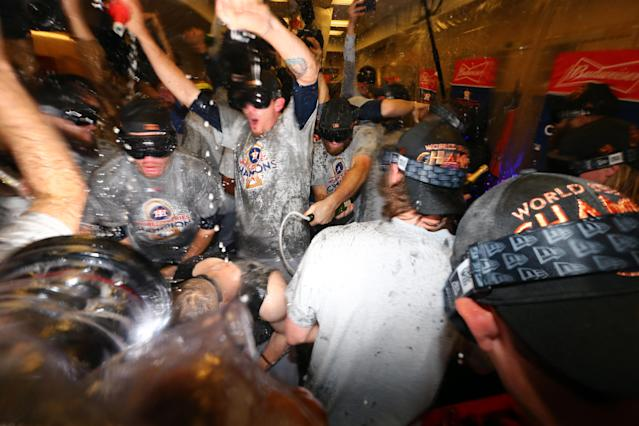<p>Members of the Houston Astros celebrate in the clubhouse after defeating the Los Angeles Dodgers in Game 7 of the 2017 World Series at Dodger Stadium on Wednesday, November 1, 2017 in Los Angeles, California. (Photo by Alex Trautwig/MLB Photos via Getty Images) </p>