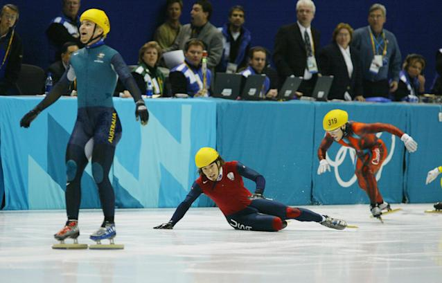 16 Feb 2002: Apolo Anton Ohno #369 of the USA gets his skate across the finish line as Steven Bradbury #300 of Australia celebrates winning the gold in the men's 1000m speed skating final during the Salt Lake City Winter Olympic Games at the Salt Lake Ice Center in Salt Lake City, Utah. Ohno collided with the rest of the finalist but was able to cross the line second to win the silver medal. DIGITAL IMAGE. Mandatory Credit: Clive Mason/Getty Images