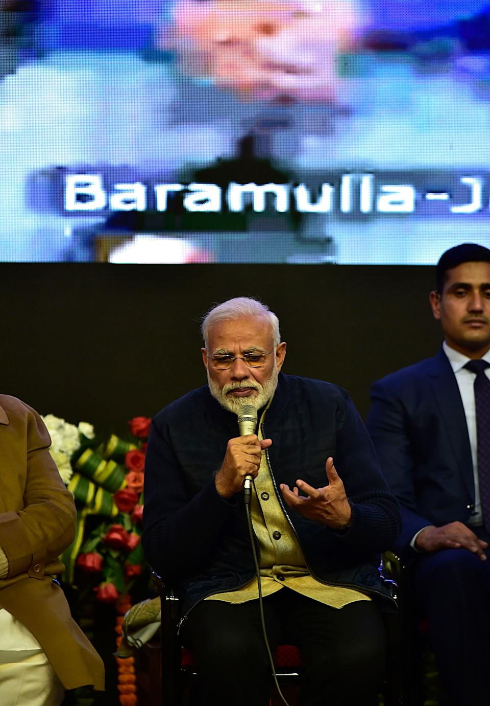 Indian Prime Minister Narendra Modi answers a question during an online interaction with students of different colleges and universities of India in Srinagar, Kashmir on February 03, 2019. Modi is on a day long visit to Jammu, Ladakh and the Kashmir Valley to lay foundation stones of projects worth Rs 35,000 crore and inaugurate projects worth Rs 9,000 crore.A complete shutdown was observed across the Kashmir valley against the visit of Indian Prime Minister Narendra Modi. The shutdown was called by the Kashmiri separatist leaders.Shops and business establishments were closed and traffic was off the roads.Restrictions were also imposed on public moment in many parts of the Srinagar city. (Photo by Faisal Khan/NurPhoto via Getty Images)