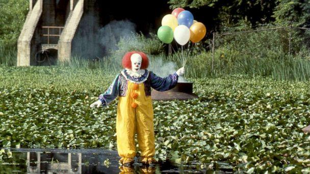 PHOTO: Tim Curry, as Pennywise, in a scene from the made-for-television movie, 'It.' (Chris Helcermanas-benge/Walt Disney via Getty Images)