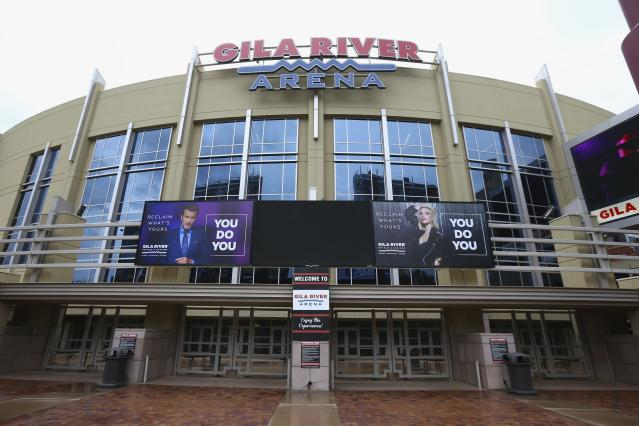 The Gila River Arena, home of the Arizona Coyotes hockey team, is closed as the Coyotes' scheduled game with the Vancouver Canucks was canceled Thursday, March 12, 2020, in Glendale, Ariz. The NHL is suspending its season amid the coronavirus outbreak, the league announced Thursday. (AP Photo/Ross D. Franklin)