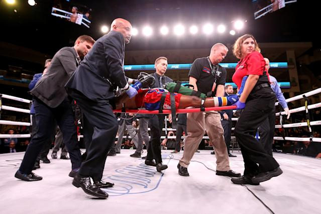 """<a class=""""link rapid-noclick-resp"""" href=""""/ncaaf/players/306757/"""" data-ylk=""""slk:Patrick Day"""">Patrick Day</a> is taken out of the ring after being knocked out during his Super-Welterweight bout against Charles Conwell in Chicago, Illinois. (Getty Images)"""