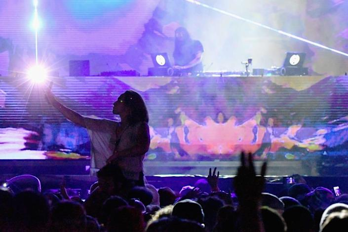 """<div class=""""inline-image__caption""""><p>Festivalgoers watch Bassnectar onstage during the Meadows Music and Arts Festival - Day 3 at Citi Field on September 17, 2017, in New York City.</p></div> <div class=""""inline-image__credit"""">Mike Coppola/Getty</div>"""
