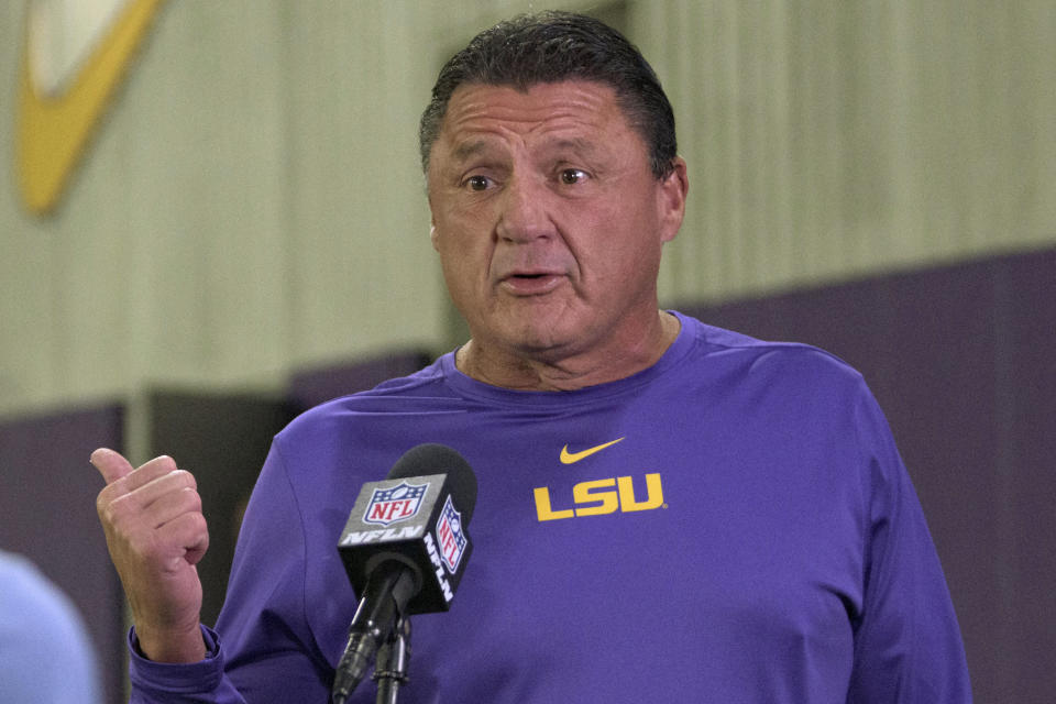 LSU head coach Ed Orgeron is interviewed during an NFL Pro Day at LSU in Baton Rouge, La., Wednesday, March 31, 2021. (AP Photo/Matthew Hinton)