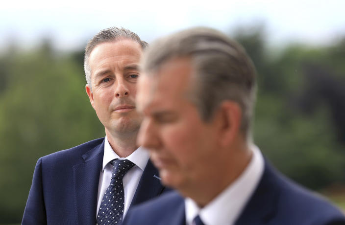 Democratic Unionist Party member Paul Givan, left, looks at party leader Edwin boots aa they face teh media at Stormont Buildings parliament in Belfast, Northern Ireland, Tuesday, June 8, 2021. Paul Givan was named as Northern Ireland's First Minister designate by the party leader Edwin Poots during a press conference Tuesday. AP Photo/Peter Morrison)
