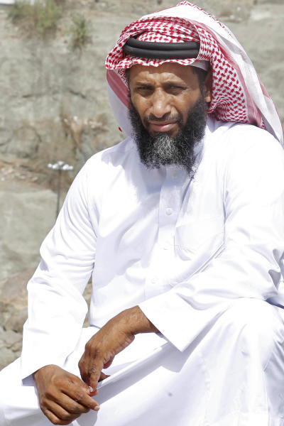 Ahmed Zuhair poses for picture in the holy city of Mecca, Saudi Arabia, Friday, June 14, 2013. Until he was released from U.S. custody in 2009, Zuhair and another prisoner had the distinction of staging the longest hunger strikes at the Guantanamo prison. Zuhair kept at it for four years in a standoff that at times turned violent. Zuhair, a former sheep merchant who was never charged with any crime during seven years at Guantanamo, stopped eating in June 2005 and kept up his protest until he was sent home to Saudi Arabia in 2009. (AP Photo)