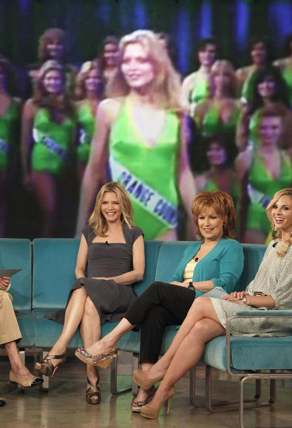 <p>At just 19 years old, Michelle Pfeiffer (pictured on the screen behind the cohosts of <em>The View</em>) was crowned Miss Orange County in 1978. She went on to compete in the Miss California pageant.</p>