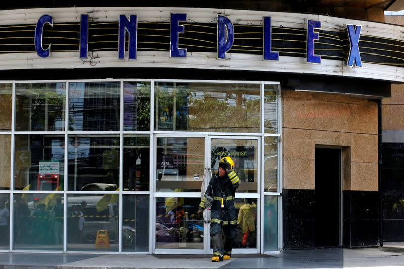 FILE PHOTO: A firefighter walks out from the Major Cineplex theatre in Bangkok