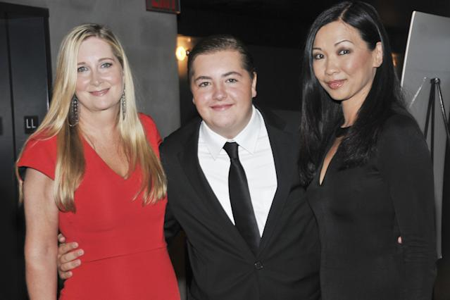 Michael Gandolfini with his mother, Marcy Gandolfini, left, and stepmother, Deborah Lin, at the New York premiere of  <em>The Drop</em>, Sept. 8, 2014. (Photo: Jenny Anderson/WireImage)