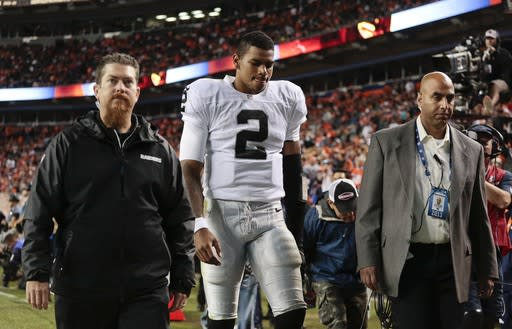 FILE - In this Sept. 23, 2013 file photo, Oakland Raiders quarterback Terrelle Pryor (2) leaves the field late in the fourth quarter of an NFL football game against the Denver Broncos in Denver. The Raiders enter a short week of preparation with uncertainty at quarterback. (AP Photo/Joe Mahoney, File)
