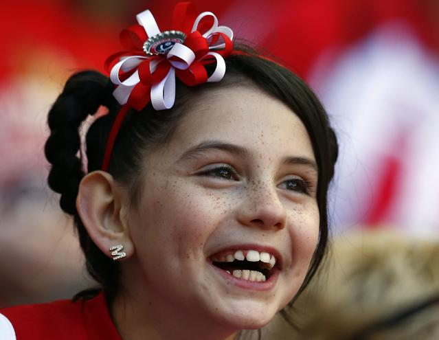 A Sheffield United fan smiles before their English FA Cup semi-final soccer match against Hull City at Wembley Stadium in London, April 13, 2014. REUTERS/Darren Staples (BRITAIN - Tags: SPORT SOCCER)