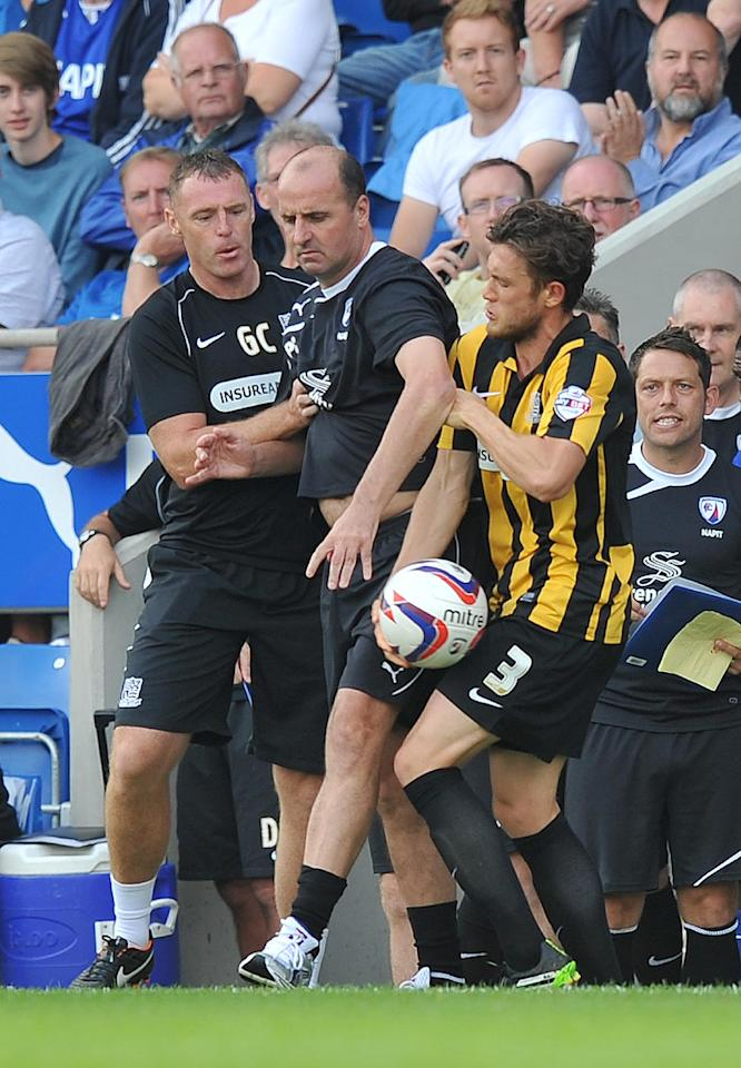 Chesterfield's Manager Paul Cook tussels with Southend United's Ben Coker over the ball during the Sky Bet Football League Two match at the Proact Stadium, Chesterfield.