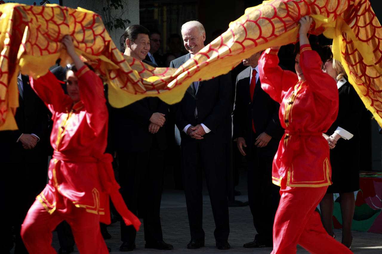 Vice President Joe Biden, right and Chinese Vice President Xi Jinping watch a dance performance during a visit to the International Studies Learning Center, Friday, Feb. 17, 2012 in South Gate, Calif. Chinese Vice President Xi Jinping began the last day of his U.S. visit Friday by urging closer ties and arguing that Americans benefit from their trade relationship with China. (AP Photo/Los Angeles Times, Jay L. Clendenin, Pool)