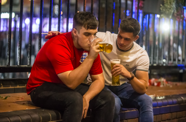 <p>This sad pair in Birmingham do the only thing they can do after the loss – nurse a couple of pints. (SWNS) </p>