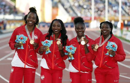 Athletics - Gold Coast 2018 Commonwealth Games - Women's 4x100m Relay - Medal Ceremony - Carrara Stadium - Gold Coast, Australia - April 14, 2018. Asha Philip, Dina Asher-Smith, Bianca Williams and Lorraine Ugen of England pose with their gold medals. REUTERS/Paul Childs