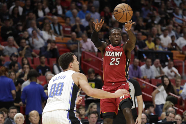 Miami Heat guard Kendrick Nunn (25) passes the ball past Orlando Magic forward Aaron Gordon (00) during the first half of an NBA basketball game Wednesday, March 4, 2020, in Miami. (AP Photo/Wilfredo Lee)