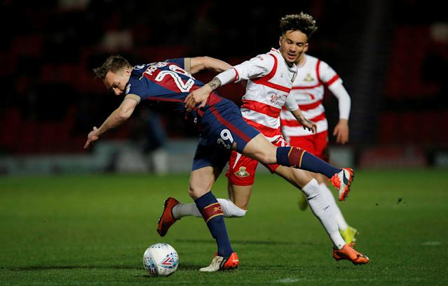 "Soccer Football - League One - Doncaster Rovers vs Bradford City - Keepmoat Stadium, Doncaster, Britain - March 19, 2018 Bradford City's Anthony McMahon (L) in action with Doncaster Rovers' Alex Kiwomya Action Images/Craig Brough EDITORIAL USE ONLY. No use with unauthorized audio, video, data, fixture lists, club/league logos or ""live"" services. Online in-match use limited to 75 images, no video emulation. No use in betting, games or single club/league/player publications. Please contact your account representative for further details."