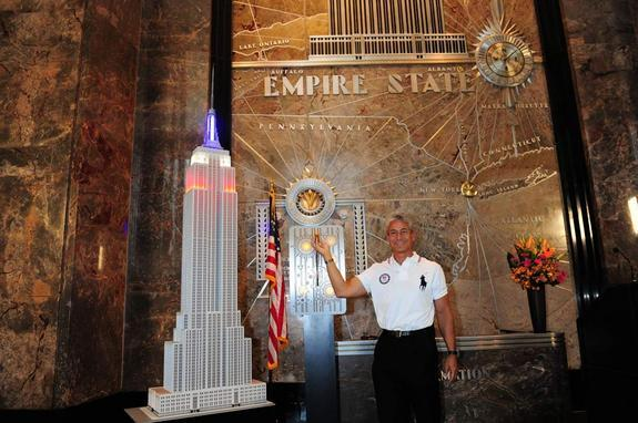 Greg Louganis, four-time gold medal winning diver (Los Angeles 1984, Seoul 1988) lights the Empire State Building red/white/blue to mark 100 days to the start of the London 2012 Olympic Games.