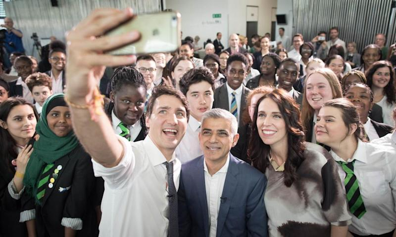 Canadian PM Justin Trudeau (left) takes a selfie with London mayor Sadiq Khan and New Zealand PM Jacinda Ardern at City Hall in London