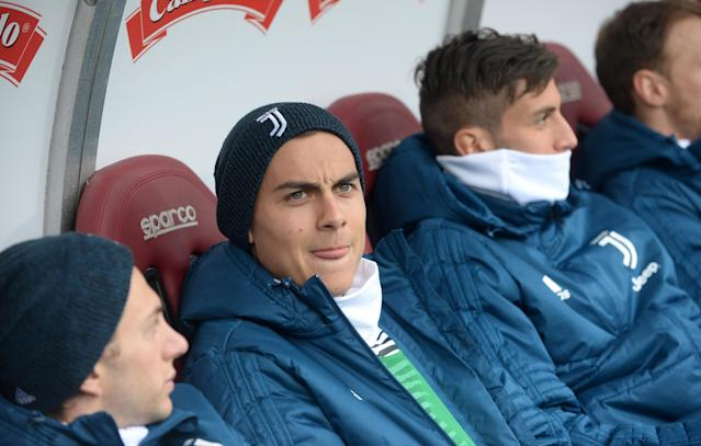 Soccer Football - Serie A - Torino vs Juventus - Stadio Olimpico Grande Torino, Turin, Italy - February 18, 2018 Juventus' Paulo Dybala sat on the bench with team mates before the match REUTERS/Massimo Pinca