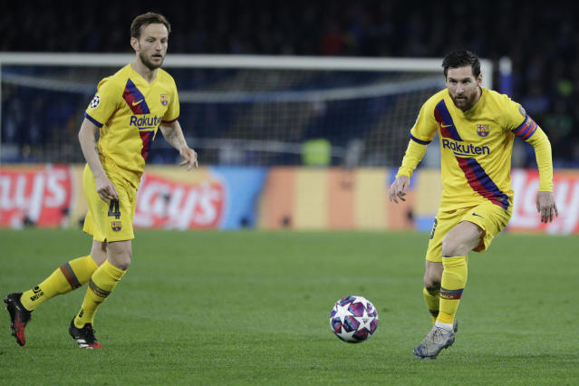 Barcelona's Lionel Messi, right, controls the ball the ball during the Champions League, Round of 16, first-leg soccer match between Napoli and Barcelona, at the San Paolo Stadium in Naples, Italy, Tuesday, Feb. 25, 2020. (AP Photo/Andrew Medichini)