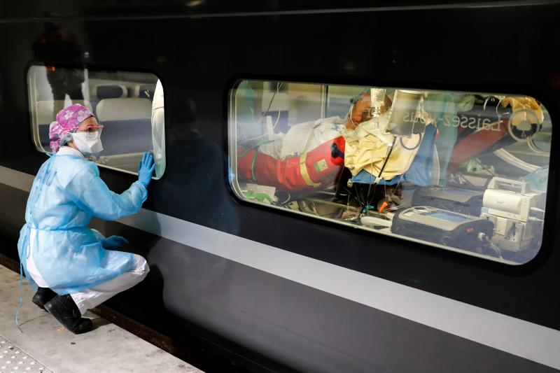 PARIS, FRANCE, April 2: A medical worker watches from a platform of the Gare d'Austerlitz train station as patients infected with the COVID-19 are transferred to hospitals in the western France Brittany region where the outbreak has so far been limited. (Photo by Thomas Samson / various sources / AFP)