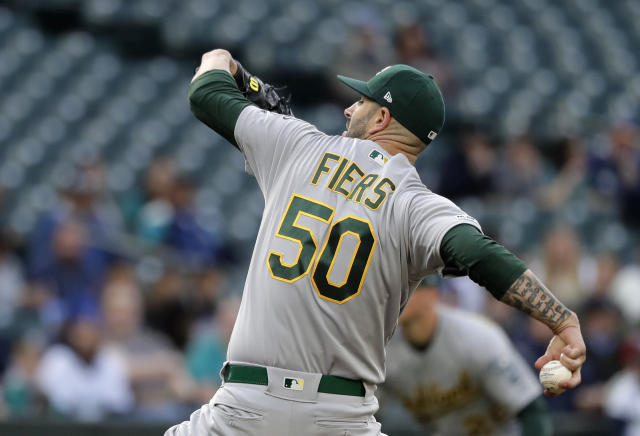 Oakland Athletics starting pitcher Mike Fiers throws against the Seattle Mariners during the first inning of a baseball game, Monday, May 13, 2019, in Seattle. (AP Photo/Ted S. Warren)