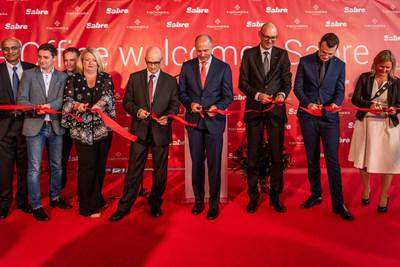 Key Sabre executives were present for a ribbon-cutting ceremony at the site that will house Sabre Poland's new global development center location. Among those pictured are Sundar Narasimhan, SVP and president of Sabre Labs and product strategy (far left); Louis Selincourt, SVP, global development centers (fifth from left); Sean Menke, president and CEO (fourth from right); and Sebastian Drzewieckit, vice president and managing director of the Poland development center (third from right).
