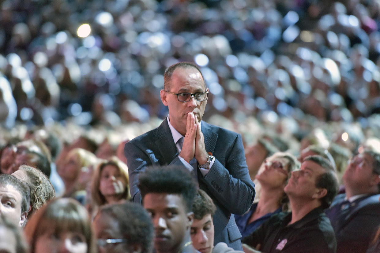 Fred Guttenberg, whose daughter Jaime died in the attack at Marjory Stoneman Douglas, watches a video honoring the 17 students and teachers killed. (Photo: Michael Laughlin/South Florida Sun-Sentinel via AP)